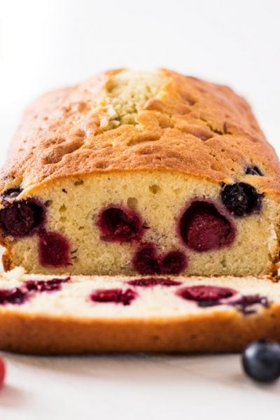 Blueberry raspberry pound cake slice inside of cake with berries