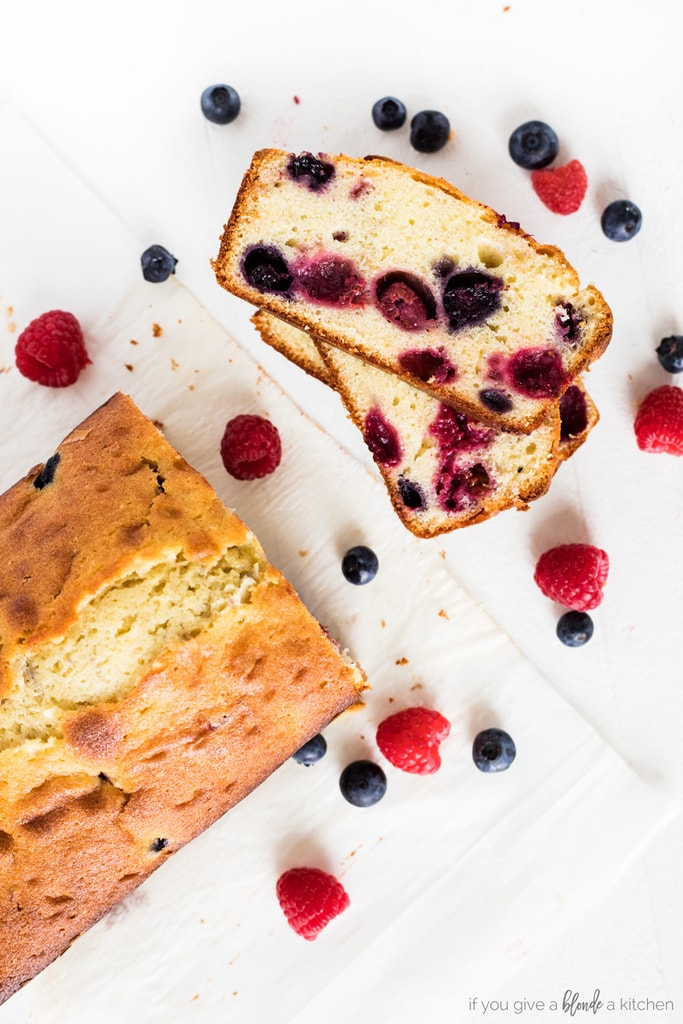blueberry raspberry pound cake loaf with slice and berries