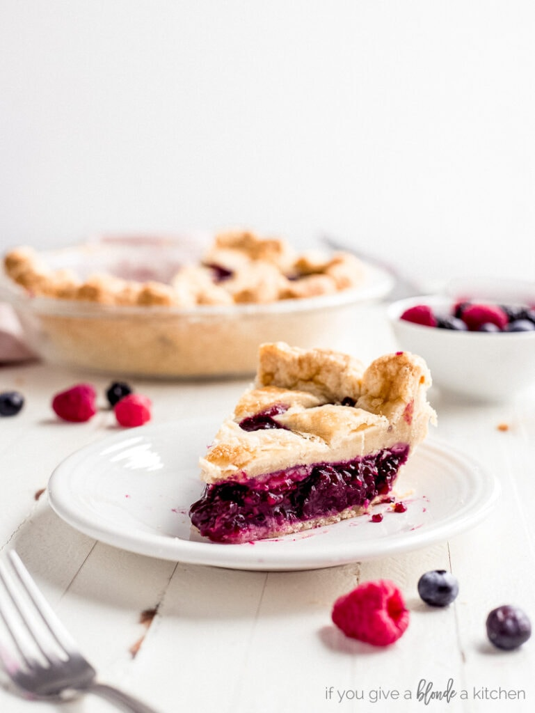 slice of berry pie on round plate
