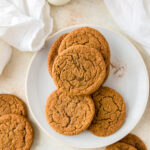 chewy ginger molasses cookies on cooling rack