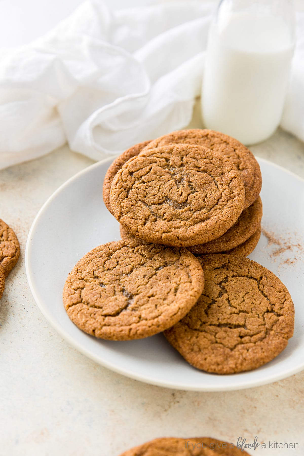 Chewy ginger molasses cookies in a stack with red baking twine