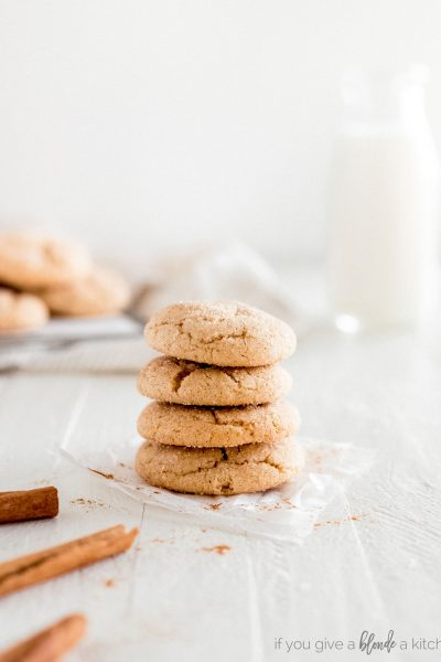 snickerdoodle cookies in a stack on parchment paper