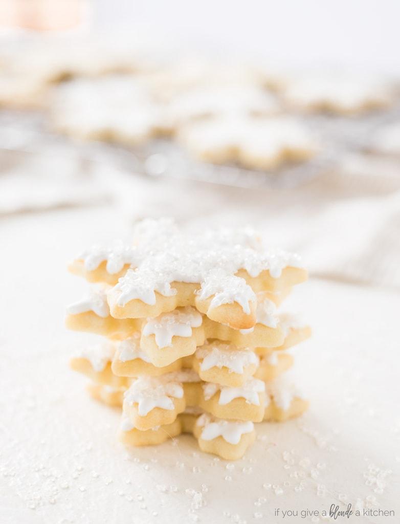 snowflake sugar cookies royal icing stack of cookies