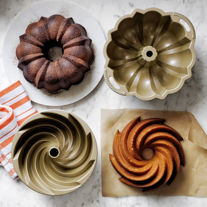 gold bundt cake pans next to bundt cakes