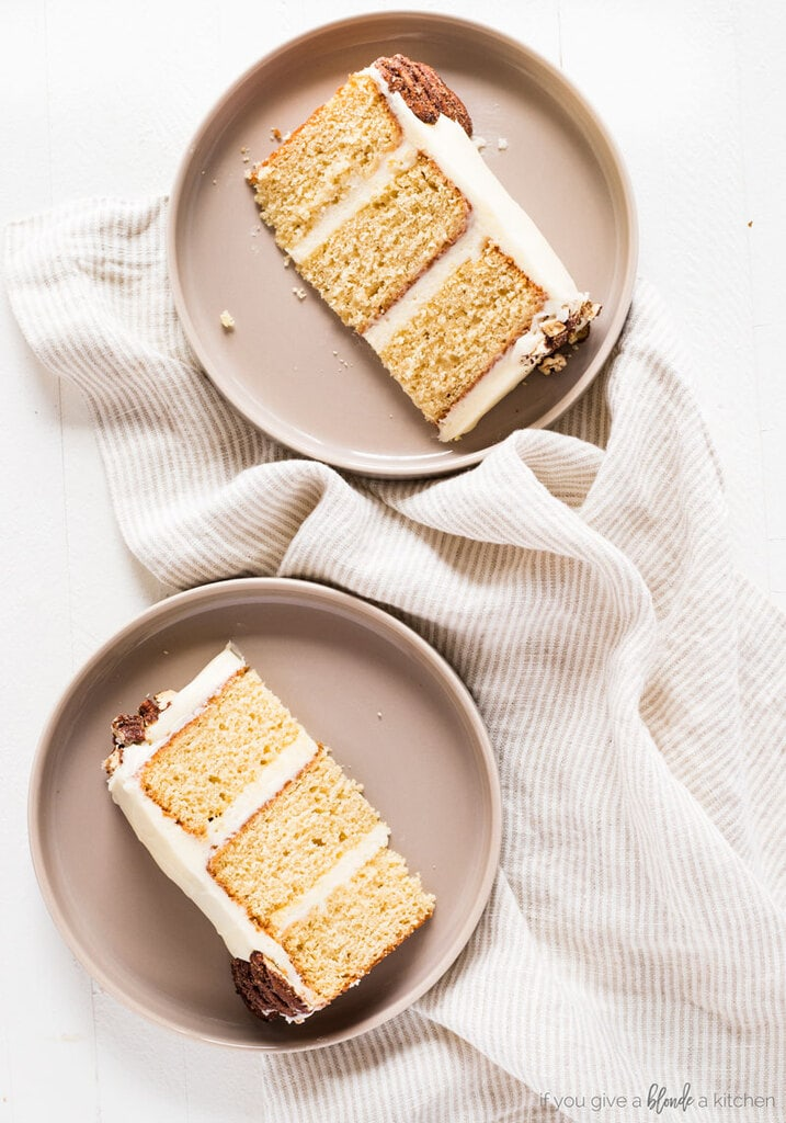 two slices of triple layer maple cake on round taupe colored plates