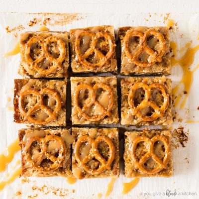 salted caramel pretzel blondies cut into square with pretzels on tops and drizzle of caramel