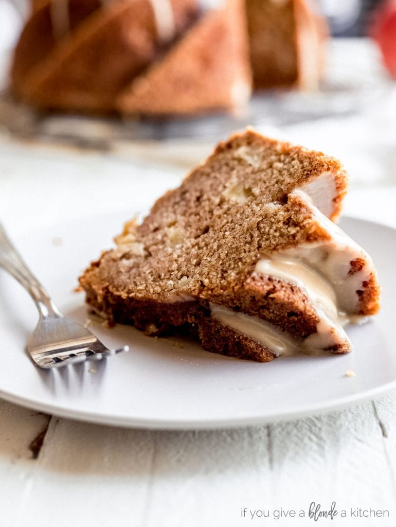 fresh apple bundt cake slice on plate with fork