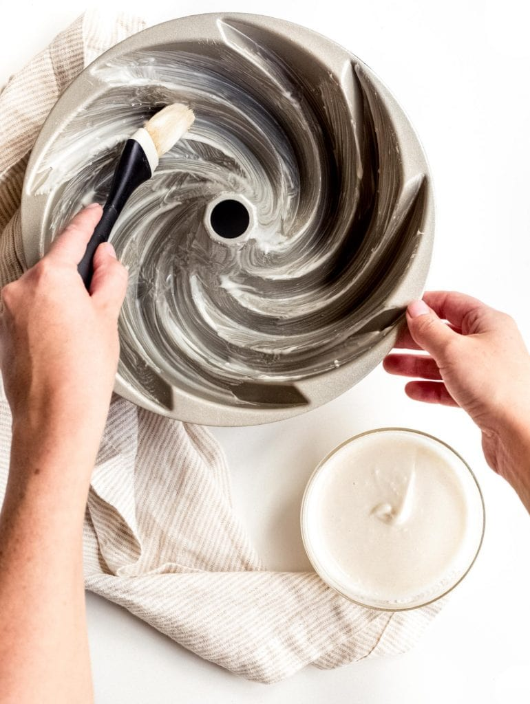 pastry brush greasing bundt cake pan