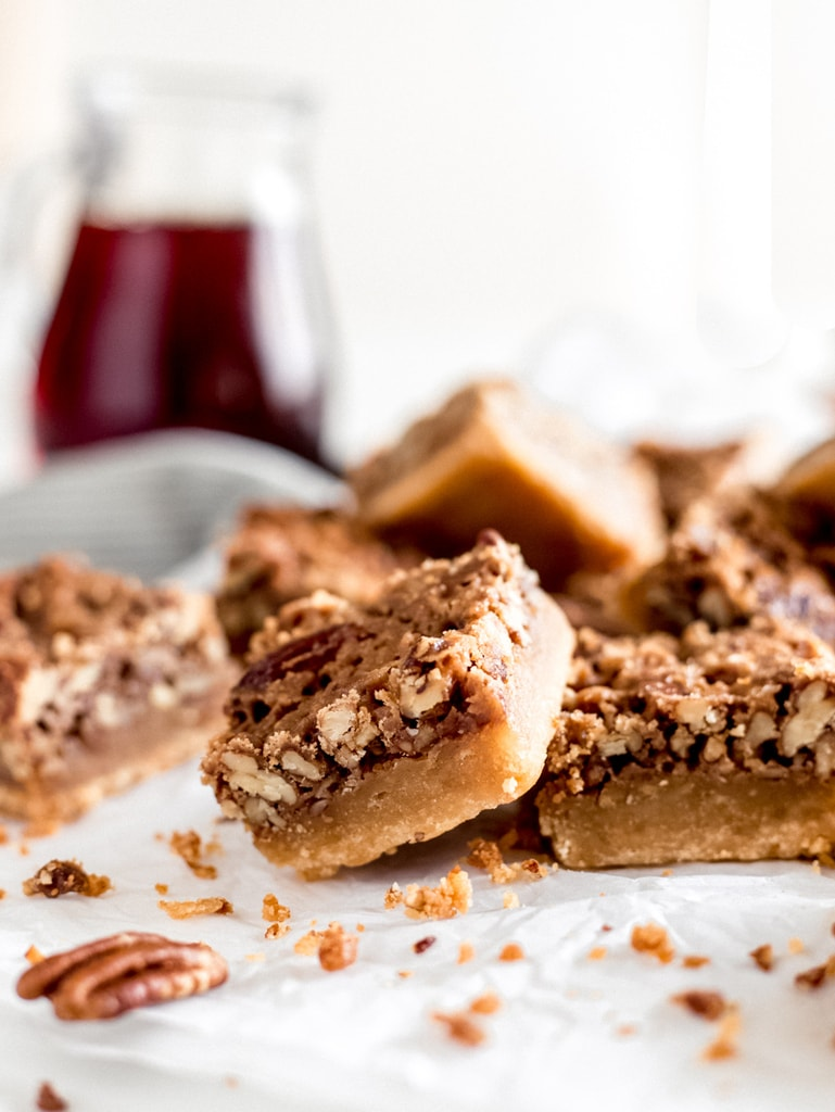 maple pecan bars showing layers of pecan pie filling and shortbread crust