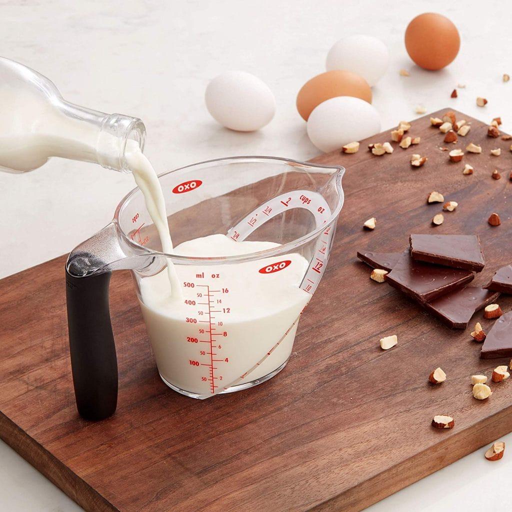 oxo liquid measuring cup milk poured in