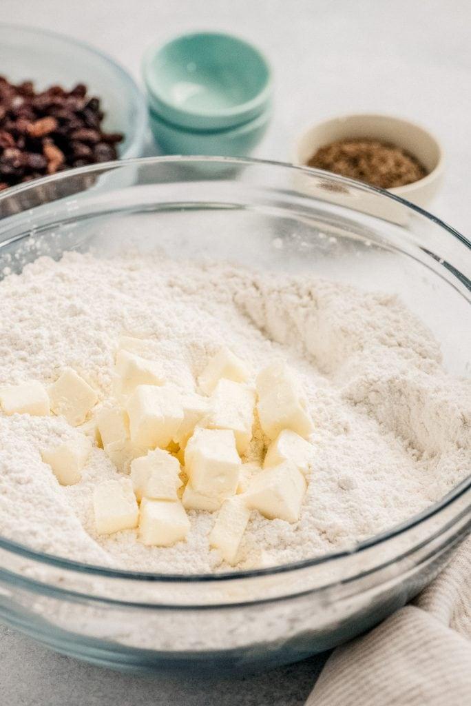 butter cubes in flour mixture