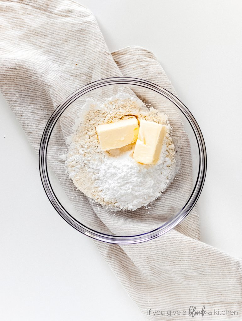 flour, confectioners sugar and butter in glass bowl
