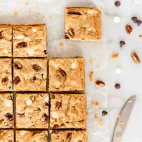 blondies cut into squares with chocolate chips and pecans