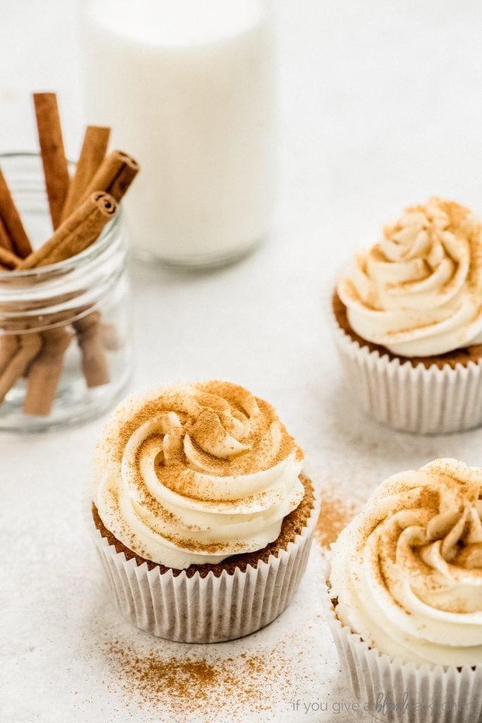 carrot cake cupcakes with cream cheese frosting and dusting of ground cinnamon