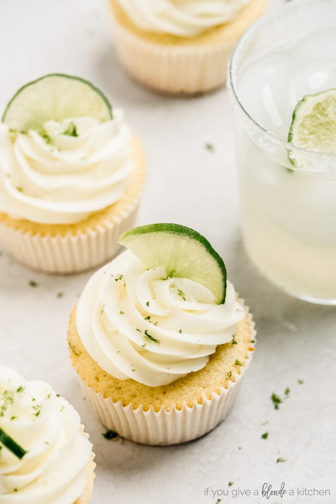 margarita cup cake with lime zest and lime wedge in frosting