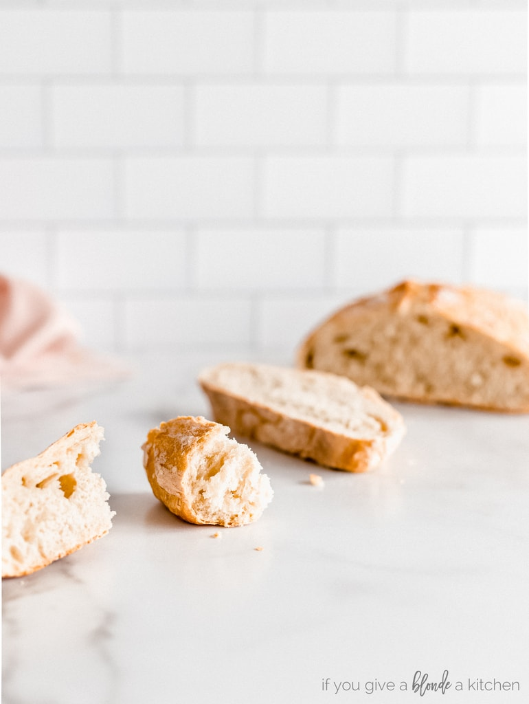 pieces of artisan bread loaf on kitchen counter