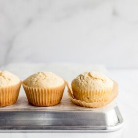 muffins on baking sheet with paper liner unwrapped