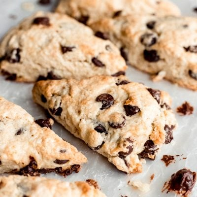 chocolate chip scones on parchment paper, melted chocolate