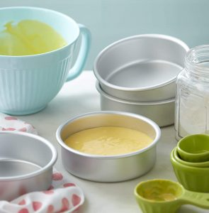 round cake pans, pan with yellow cake batter