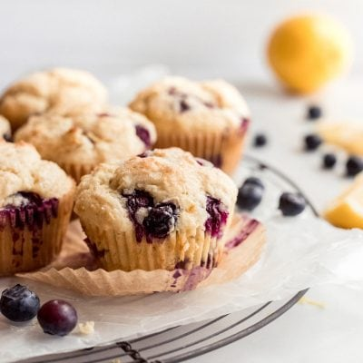 blueberry muffin, paper liner unwrapped, round cooling rack