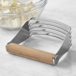 wooden hand pastry cutter, bowl of butter