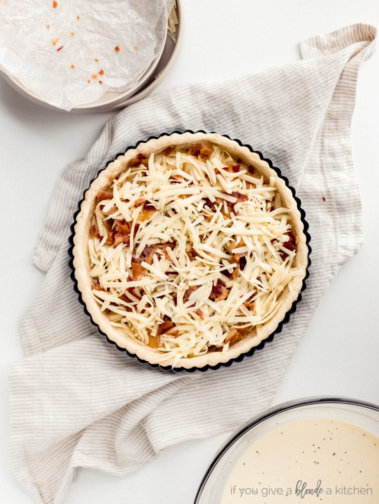 pre-baked tart shell filled with gruyere cheese and bacon