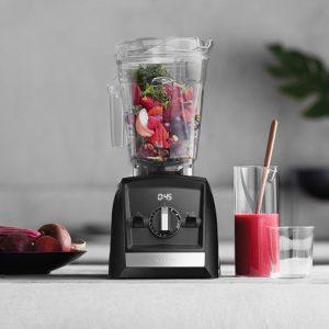 vitamix blender, fresh berries inside