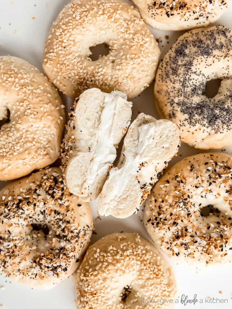 homemade bagels with center bagel cut open with cream cheese