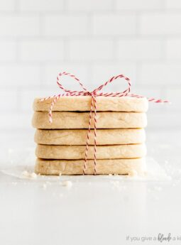 stack of rectangle shortbread cookies tied up with red bakers twine