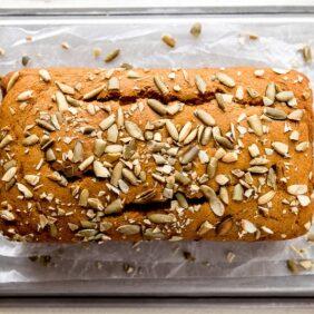 top of pumpkin bread sprinkled with pumpkin seeds
