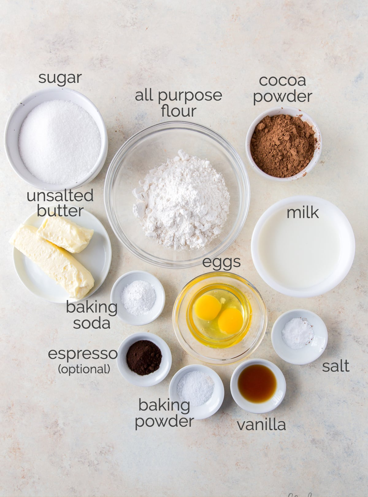 chocolate cupcake ingredients in bowls labeled with text