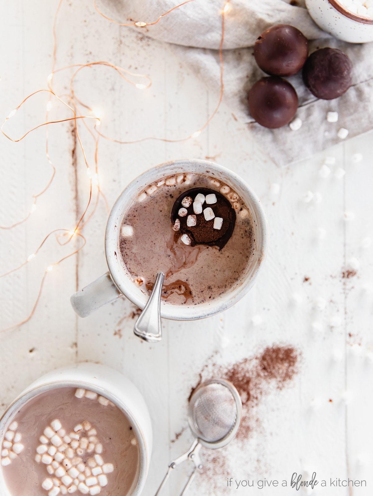 mug of hot chocolate with floating hot chocolate bomb and mini marshmallows inside