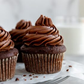 chocolate cupcakes topped with chocolate buttercream frosting