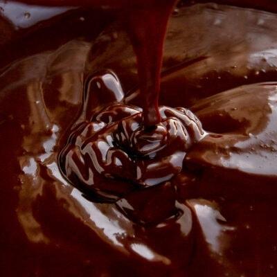 chocolate ganache dripping into more chocolate ganache