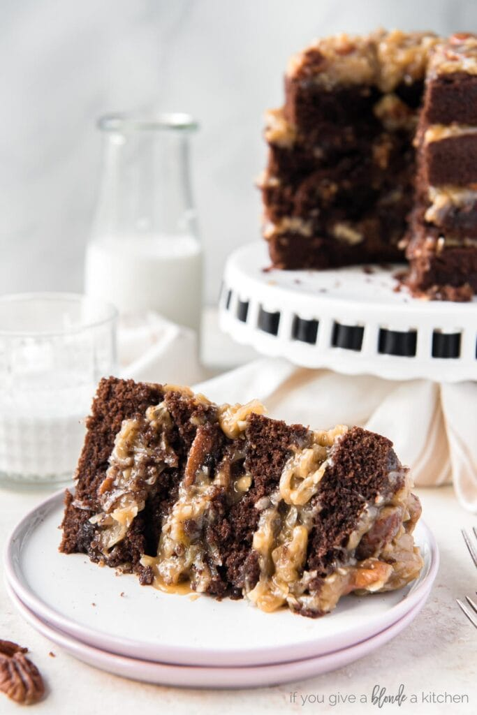 slice of german chocolate cake with coconut filling on white round plate