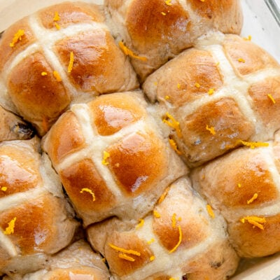 hot cross buns with glossy glaze and orange zest on top