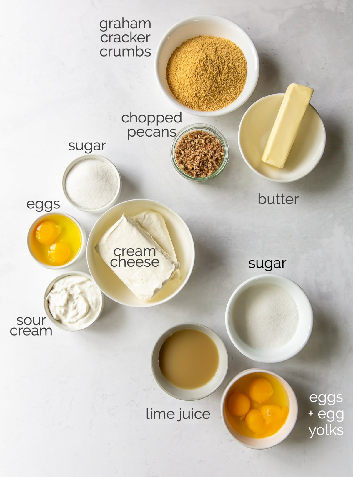 lime curd cheesecake ingredients in bowls
