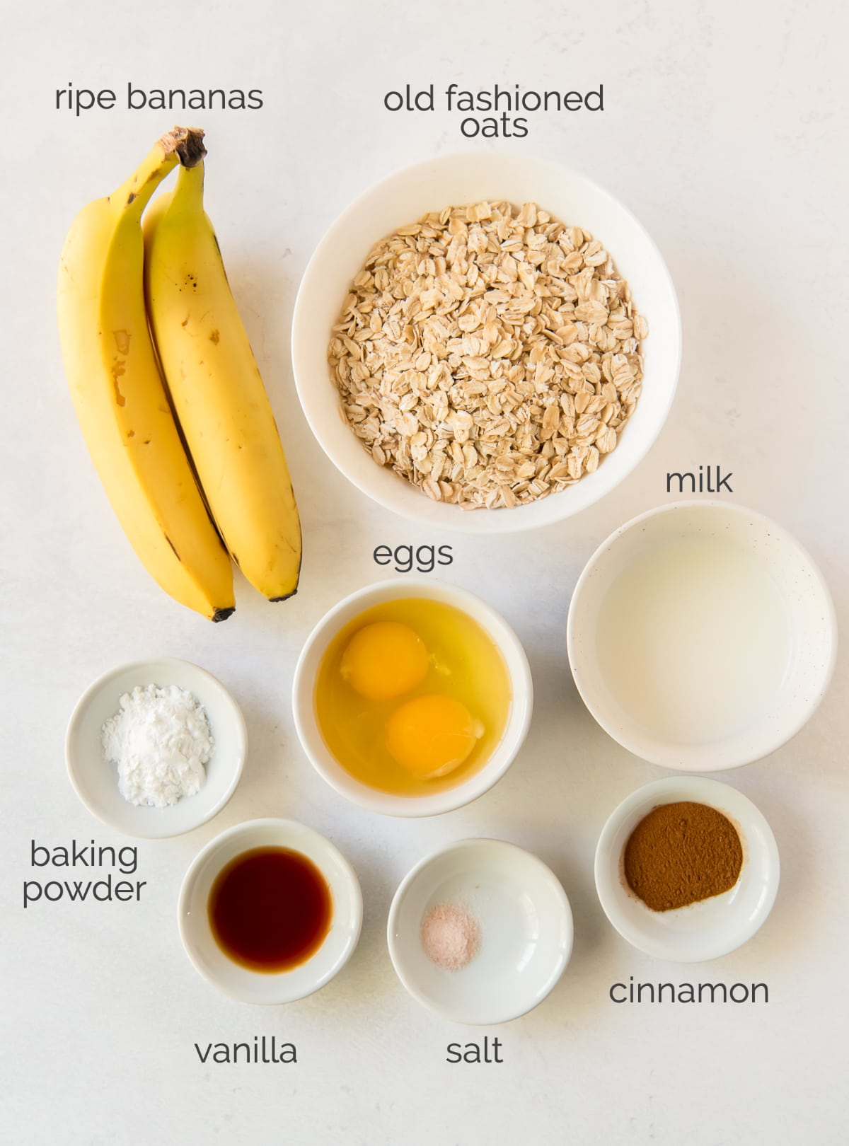banana oatmeal pancakes ingredients in bowls