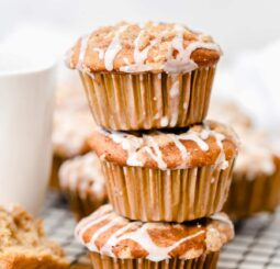 stack of three coffee cake muffins with streusel and icing