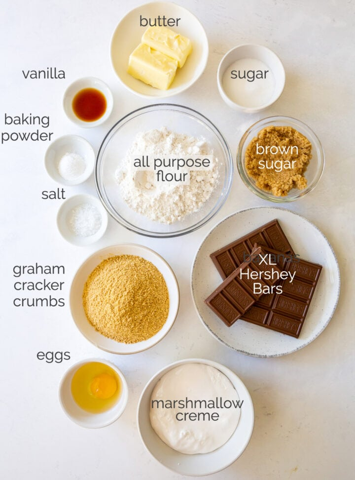 smores bars ingredients in bowls labeled with text