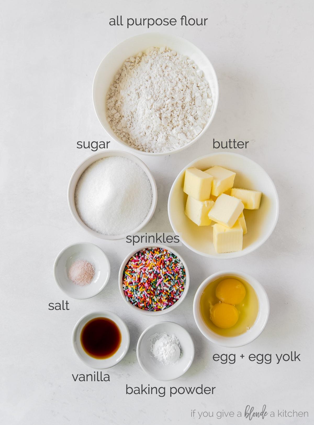 sprinkle sugar cookie ingredients in bowls