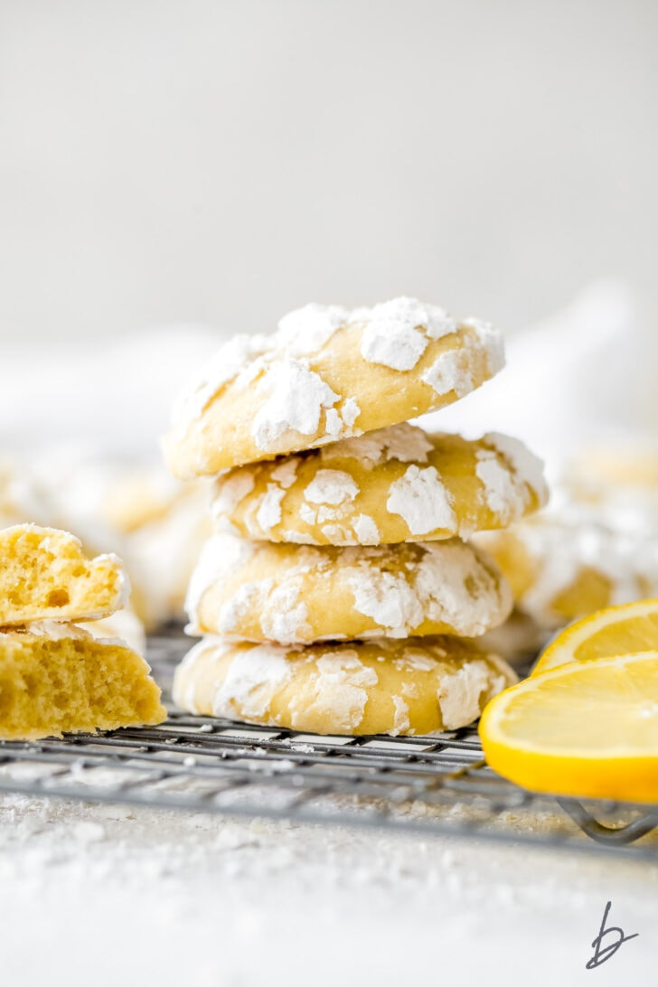 stack of four lemon crinkle cookies with confectioners' sugar