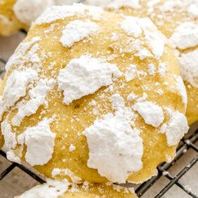 lemon crinkle cookie propped up on more cookies