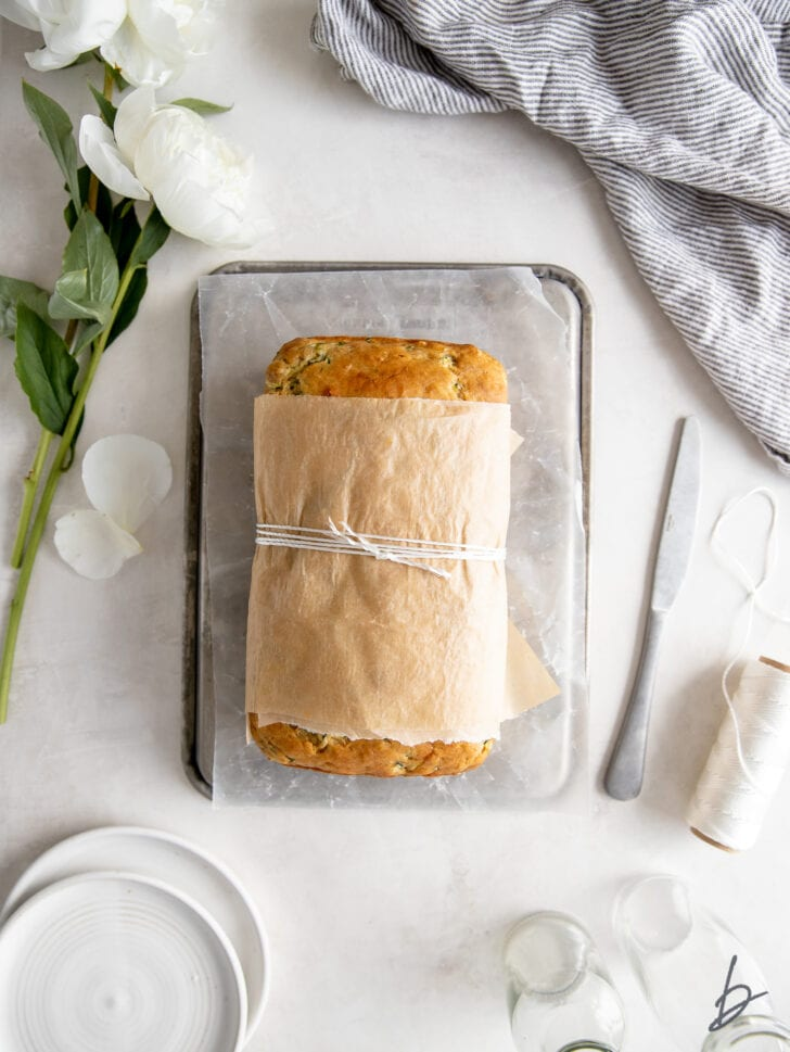 zucchini banana bread wrapped in parchment paper and tied with baking string