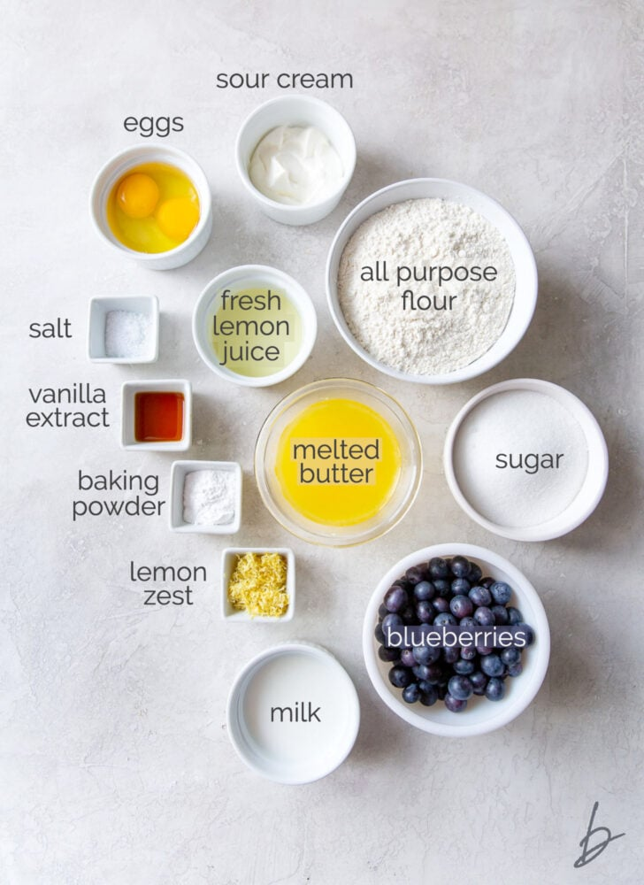 lemon blueberry bread ingredients in bowls labeled with text