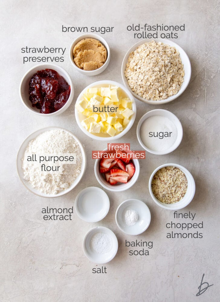 strawberry oatmeal bars ingredients in bowls with text