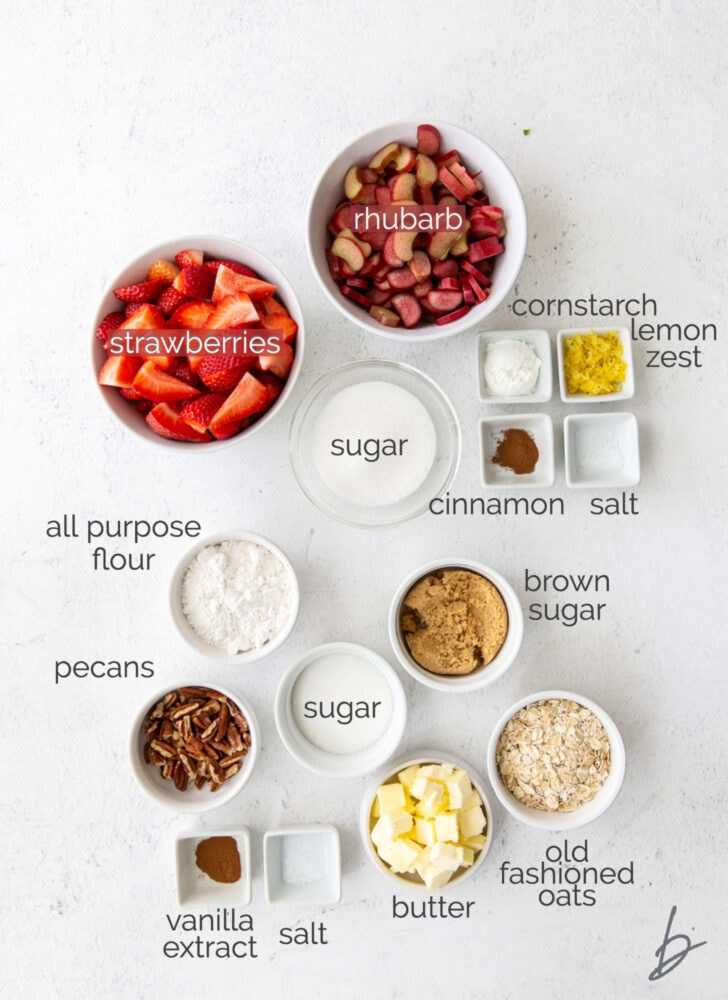 strawberry rhubarb crisp ingredients in bowls labeled with text