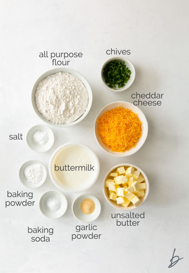 cheddar biscuit ingredients in bowls labeled with text