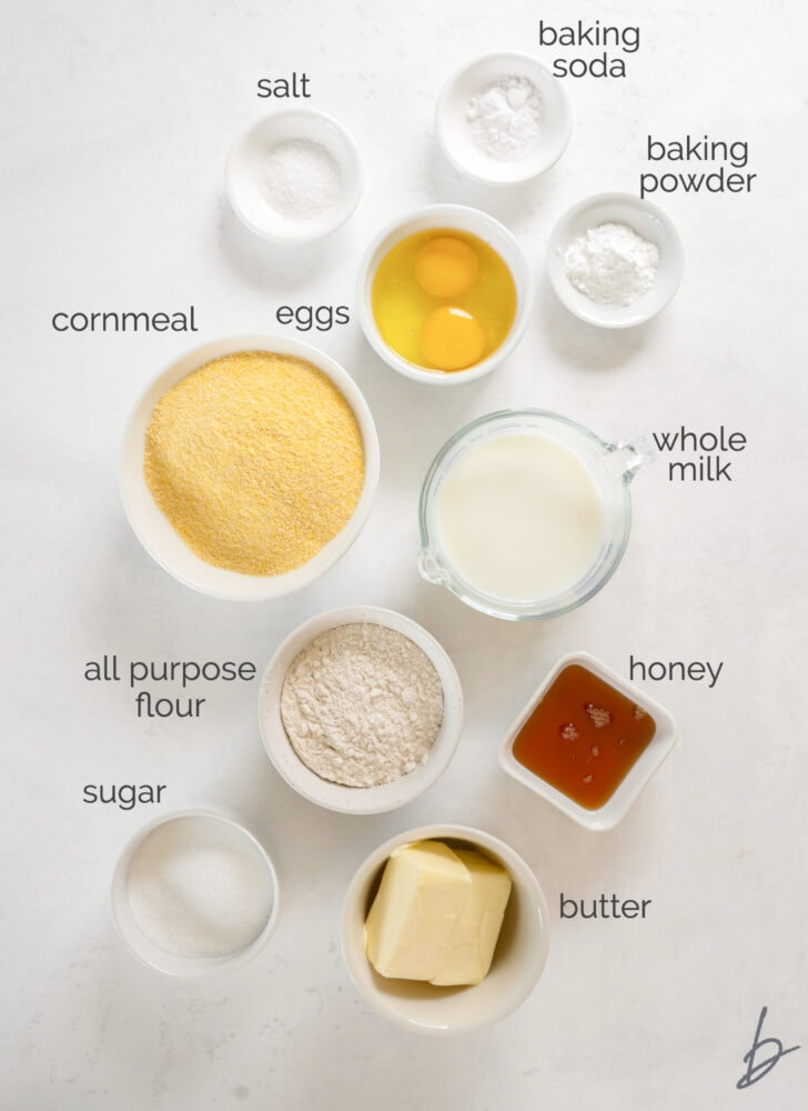 cornbread muffin ingredients in bowls labeled with text
