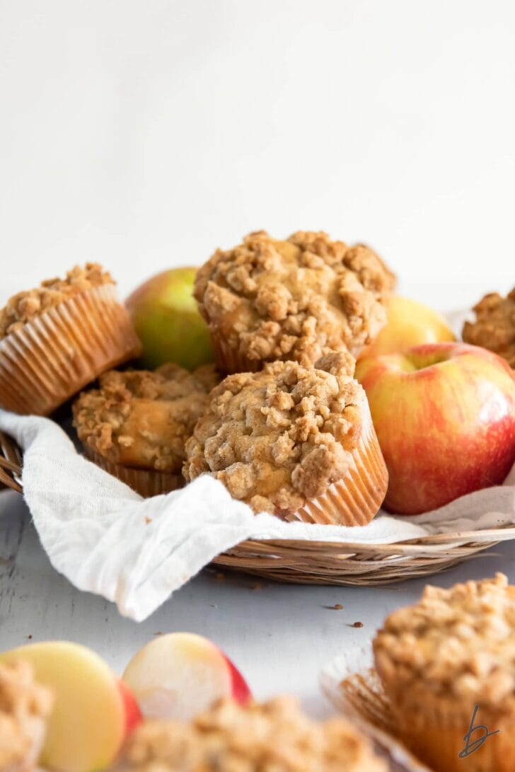 basket of apple crumble muffins and honey crisp apples